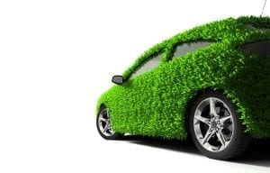 Composite of a car with a well-manicured lawn covering its exterior